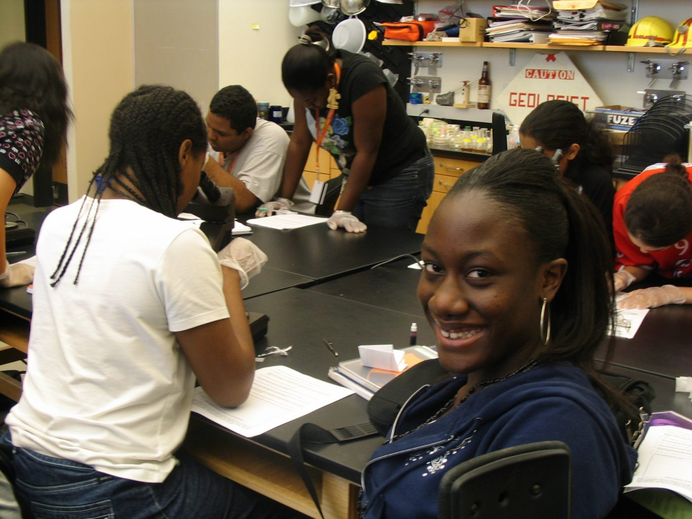 Scholar from the Class of 2010 smiling at the camera during her senior science course.