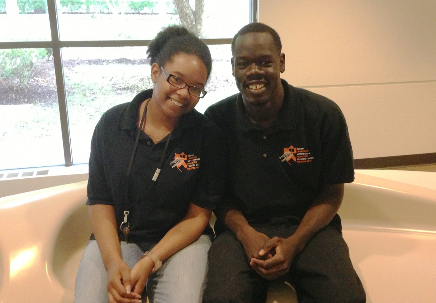 Two scholars from the Class of 2014 smiling as they wait for their tour at Rutgers University - Camden to begin.