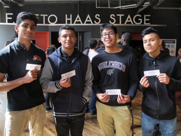 students holding theater tickets at the theater