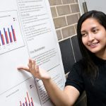 Scholar from the Class of 2017 presenting her science research project at the annual Research Symposium